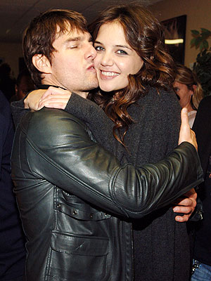 Tom Cruise attempts to embrace his wife like a hetero.